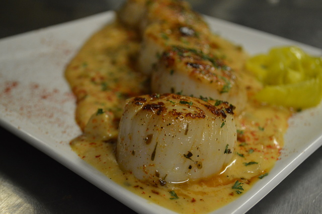Sea Scallops over Creole sauce